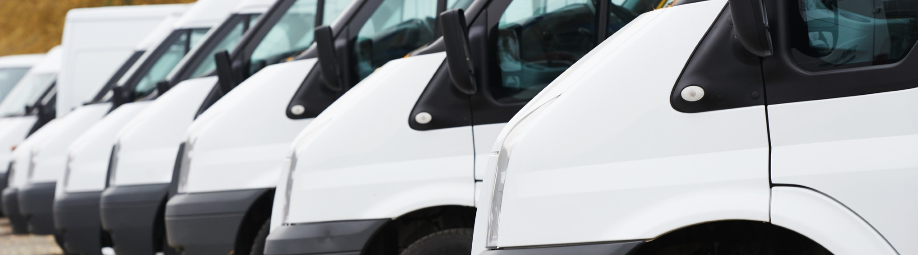 Row of commercial vans representing business insurance